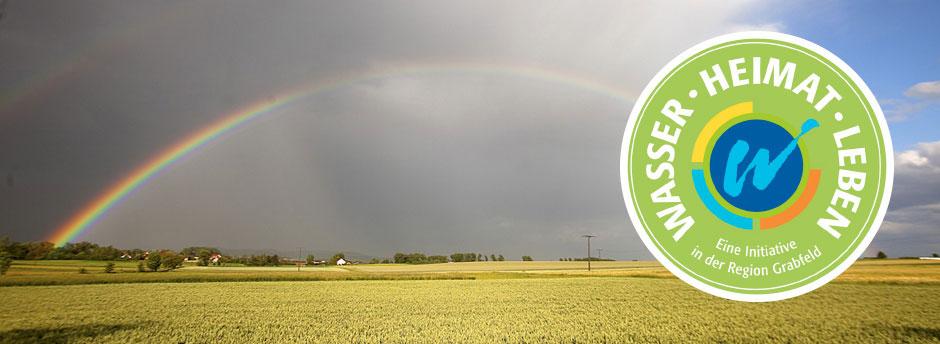 Logo der Initiative Wasser-Heimat-Leben vor Regenbogen